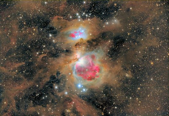 Dust of the Orion Nebula . The entire Orion field, located about 1600 light years away, is inundated with intricate and picturesque filaments of dust. Opaque to visible light, dust is created in the outer atmosphere of massive cool stars and expelled by a strong outer wind of particles. Image Credit & Copyright: Nicolás Villegas