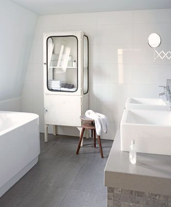 I love the simplicity of this bathroom and the vintage cabinet is perfection.