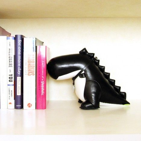Dinosaur Bookend by Zuny: PU leather with polyester and iron sand innards. $48
