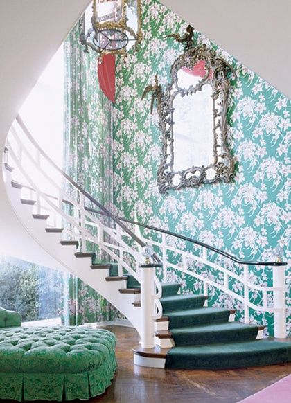 A grand and colourful staircase and i do love that mirror.