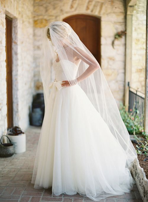Beautiful bridal gown.  Loving the veil as well.