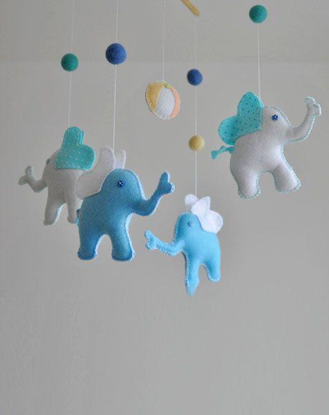 Elephant Mobile by GetaHandmadeGift: Made of felt, wood and wool balls. #Mobile #Elephant #Babies #GetHandmadeGift