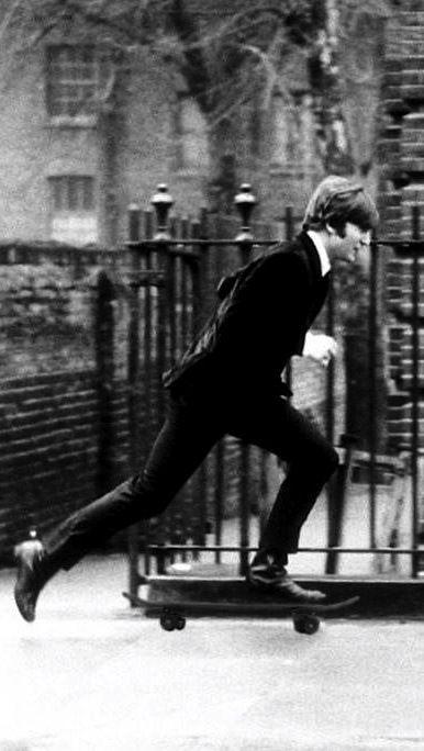 John Lennon skateboarding. S)