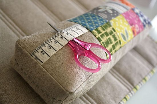 Lovely pin cushion with section of a measuring tape included