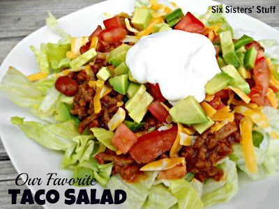 Our family's favorite Taco Salad- everyone builds their own just the way they like it. The meat is what makes this dish. SixSistersStuff.com #salad #recipe