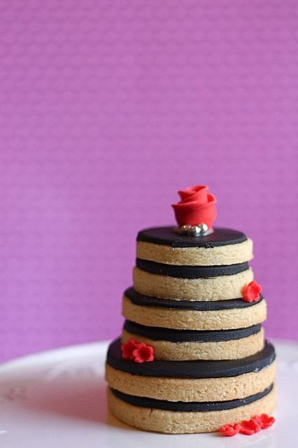 Stacked cookies to make the shape of a wedding cake.