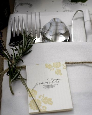Place cards are tied with twine around the napkin at each setting