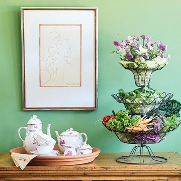 Create a lovely Easter display using an inexpensive terra-cotta saucer, fresh garden veggies and a tiered wire basket.