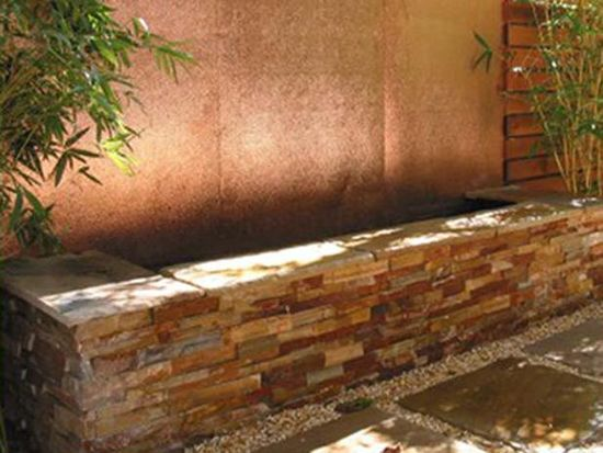 Hammered Copper waterfall for out door garden space. Could be a great way to cha
