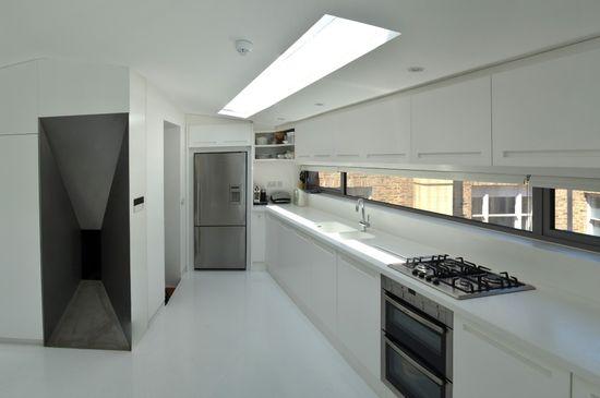 Modern Kitchen Design in Loft Extension, London by Belsize Architects