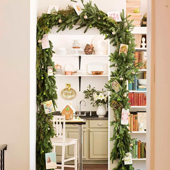 Dress Up Doorways using evergreen garland and Christmas cards