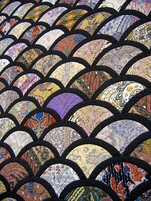 Make these half circles big enough & this design could be used as an I Spy quilt. love this. Great use of leftover asian fabrics.