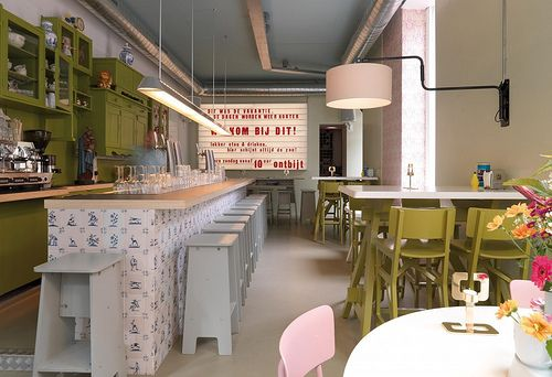 love this little restaurant. Look at the wall of painted furniture for storage.