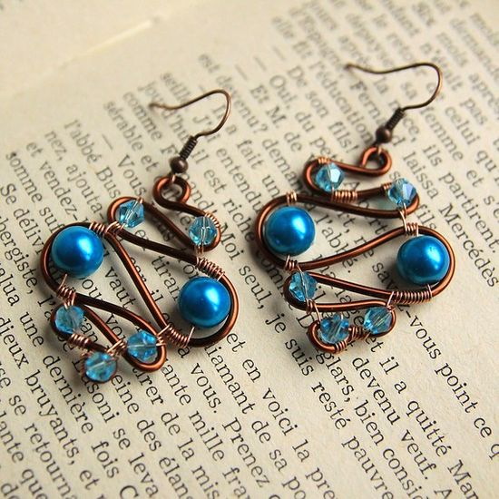 wired earrings with blue pearls and faceted glass beads