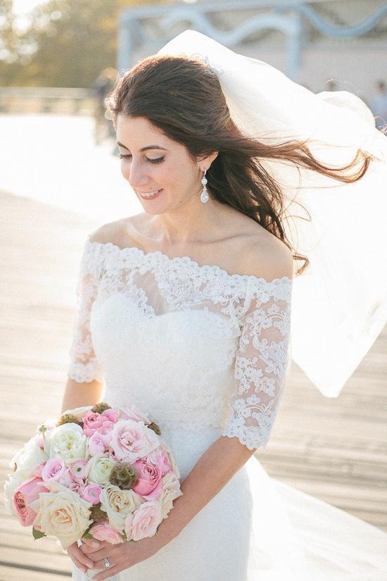 Another view - Alencon Lace bolero + LaSposa strapless gown. Photography by carmensantorellis..., Floral Design by flowersbybernard.com