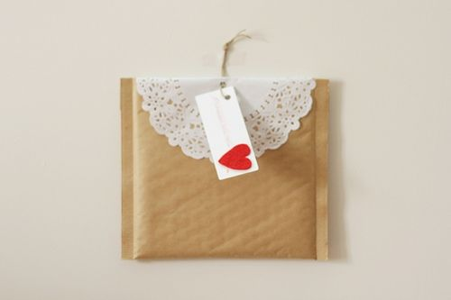 spruce up a bubble mailer with a doily...cute!