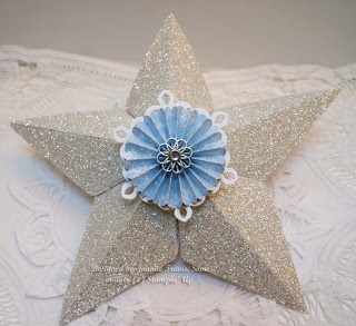 Tree topper made using Stanpin' Up silver glitter paper. Sizzix five point star die embellished with a rosette and filigree brad.