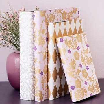 Elegant Book Jackets  -  Lovely handmade papers make these journals more than just a good read. Remove the existing jackets and use as a pattern. Cut the paper to size and then replace the original jacket with the new cover for