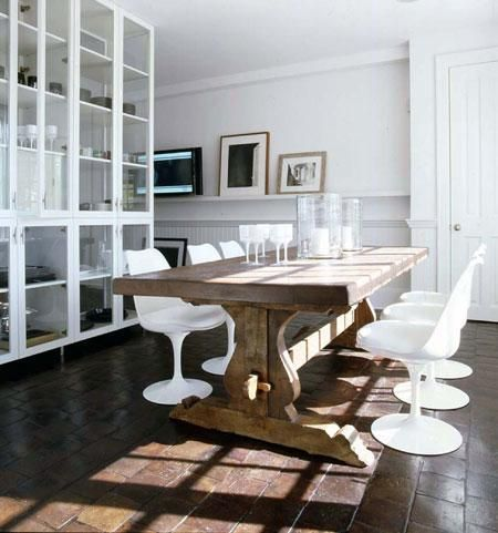 love the modern white chairs with natural wood table