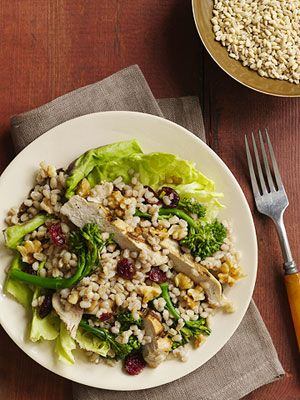 Chicken combined with barley, broccoli, and dried cranberries drizzled with a raspberry vinaigrette dressing makes a healthy salad supper for your family in less than 30 minutes.