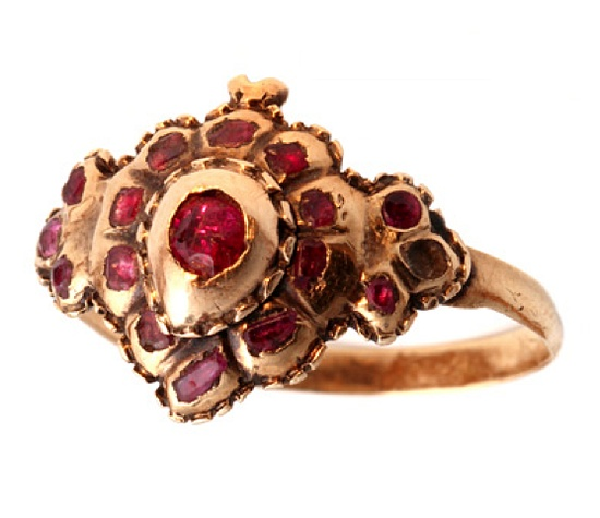 "This 18th Century ring dates in the range of 1700-1760. Flat cut garnets set in 18k gold form the shape of a 'witches heart'.    The witches heart was a romantic symbol of ""you have bewitched me"". The ring is considered Iberian as it's origin is Spain or Portugal"