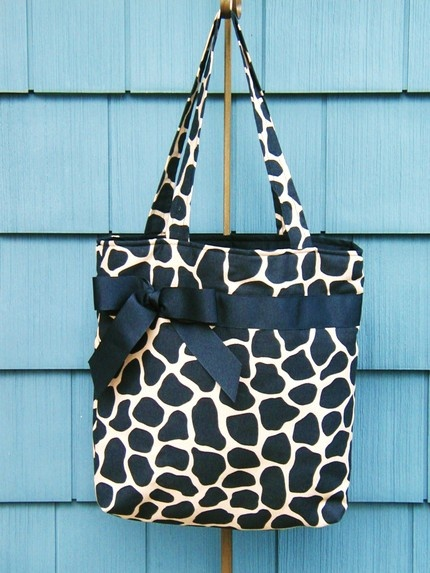 Giraffe print and bow purse