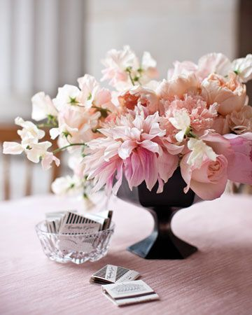 Like the black vase with the blush flowers.