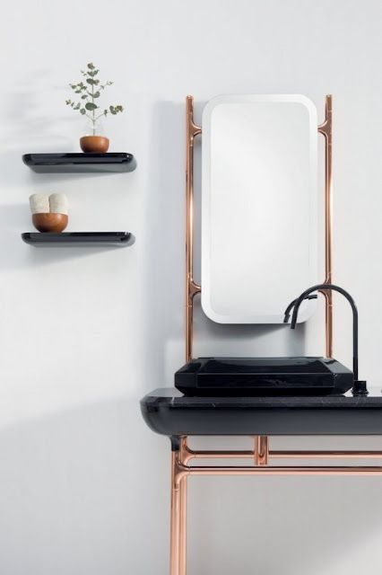 bathroom: black sink; copper pipes