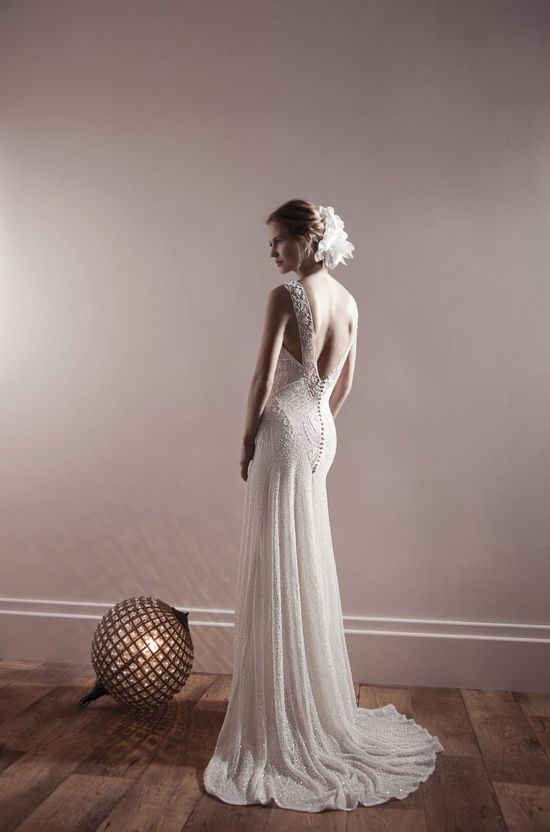Get inspired: A stunning statement backless wedding gown. So dramatic! #weddings - Find more like this at www.myweddingconc...