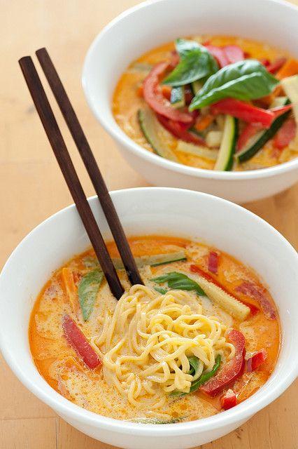 veggie laksa (coconut milk noodle soup) - 3/4lb (350g) fresh Singapore noodles, 2oz (60g) Laksa paste or other Thai curry paste, 1 large can (1 1/2 cups) coconut cream, 2 cups mixed chopped vegetables, handful fresh basil leaves