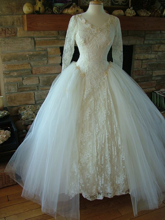 Beautiful vintage 1950s fashion forward wedding dress bridal gown with lace tulle sequins and beads. $599.00, via Etsy.