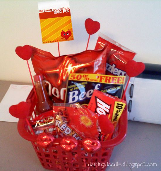 The red basket is from the Dollar Store, as are the hearts on the sticks and chocolate lips.  Inside you will find:  Hot Sauce  Big Red Gum  Red Hots  Hot Tamales  Spicy Beef Jerky  Doritos  Twizzlers  Cherry Chapstick  Cinnamon Bears   I think this is a perfect gift for a guy while still being cutesy enough to be fun and special.  cute for valentines day lol