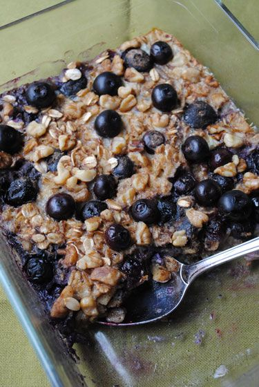 Blueberry Baked Oatmeal - bake once & have breakfast for the week, just reheat a serving each day- 200 cal.1 cup old-fashioned rolled oats  1/4 cup chopped walnuts, divided  1/2 tsp. baking powder  3/4 tsp. ground cinnamon  Pinch of salt  1/4 cup honey    1 cup milk     1 large egg,    2 tbsp.   butter,   1 tsp. vanilla extract  2-3 ripe bananas   1 cup blueberries or raspberries, fresh or frozen