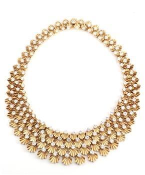 BULGARI. A HIGHLY ARTICULATED YELLOW GOLD AND DIAMOND DEMI PARURE.