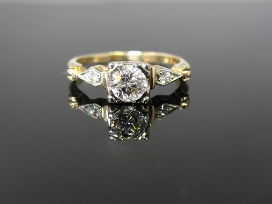 I love the vintage jewelry from this Etsy shop.  They have a brick and mortar store in the Boston area.  Unique rings!