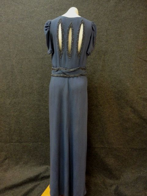 30s Dress // 1930s Evening Dress // Vintage 1930s Blue Rayon Crepe Dress with Beaded Cutouts from The Evening Room Bullocks M. $495.00, via Etsy.