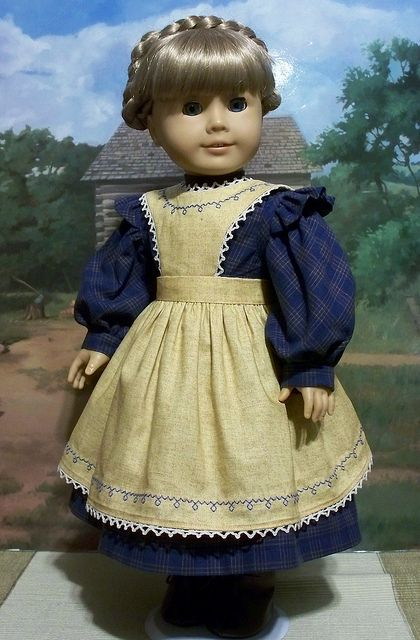 Medium blue prairie dress and gold colored apron by Keepersdollyduds, via Flickr