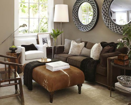 Brown couch in the basement, cream chair or patterned, lighter ottoman