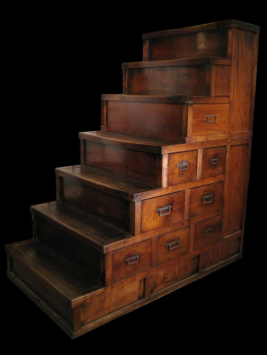 "Make this out of card catalogues and wood crates. In a smaller scale would be good ""pet steps"" for easy bed access...+ storage!"