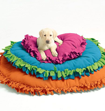 I've seen blankets made this way but I never thought to stuff them and make a dog bed! Would be good for kids too!