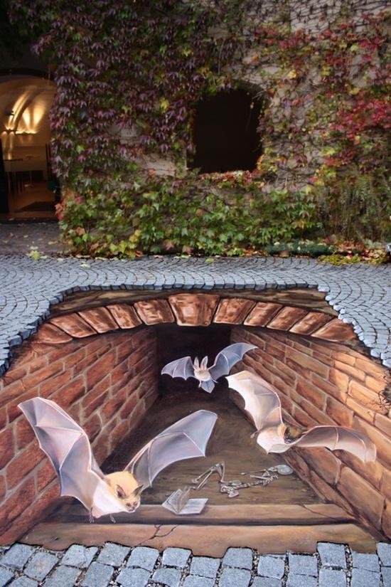 Sidewalk art ... 3D look ... bats flying up from underground