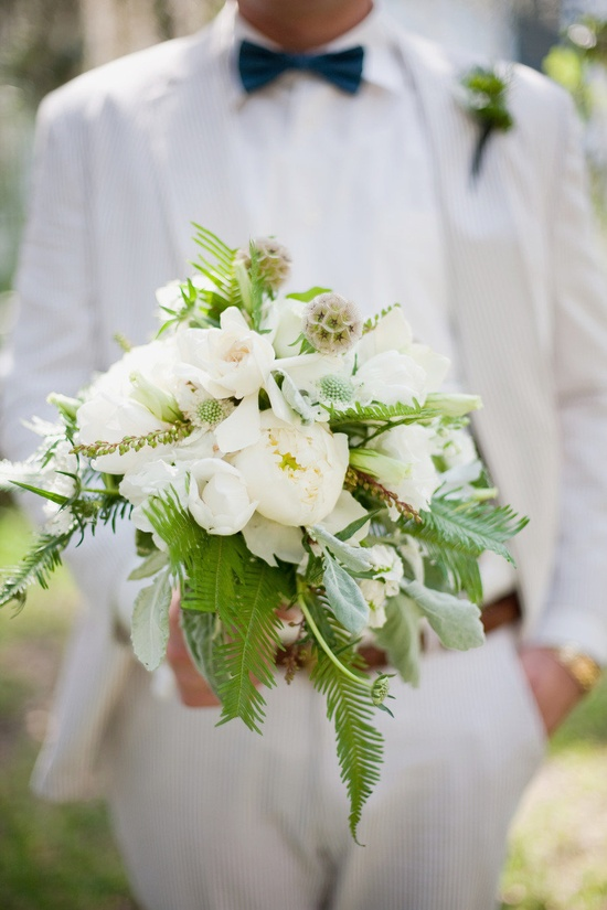 a summery white bouquet held by a dapper lad in seersucker  Photography By miamorefoto.com, Floral Design By  singletarysflower...