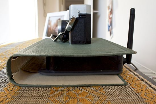 Use an old book cover to hide your internet router