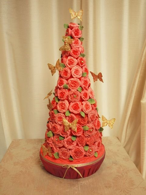 Alice pink roses cone wedding cake        by cakes from the sweetest thing (Susan), via Flickr