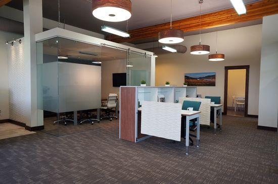 Modern, open office design by Hatch Interior Design, Kelowna, BC. Global Floorplay furniture highlighted here with the glass enclosed boardroom in the distance.