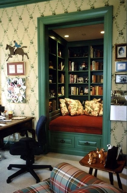Closet library...I greatly admire the fictional person who feels she has enough closet space in her house and can spare one for a reading nook.  (traditional family room by Susan Jay Design)