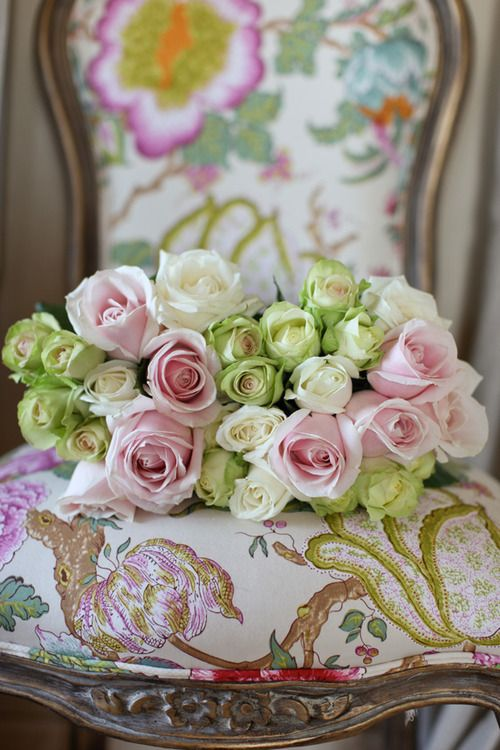 Fresh roses and chair.