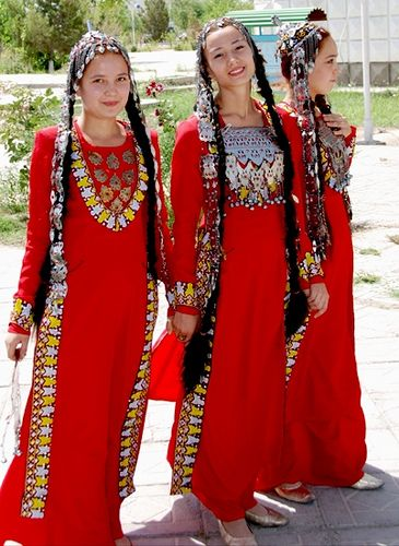 Young Turkmen girls in traditional costumes
