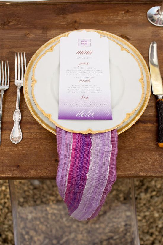 lovely place setting with patterned napkin. I'd love to see more natural tables and doing linens a different way.