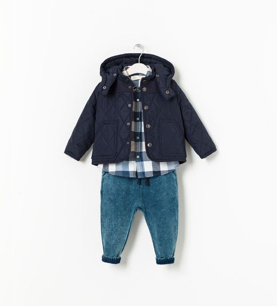 Navy quilted jacket and hood with blue plaid shirt and faded trousers for infant baby boy